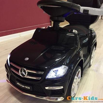 Толокар Mercedes-Benz GL63 A888AA-H с ручкой и качалкой черный (музыка, свет фар и колес, колеса резина, сиденье кожа)